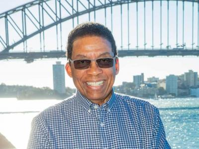 Herbie Hancock poses for a photo in front of the Sydney Harbour Bridge